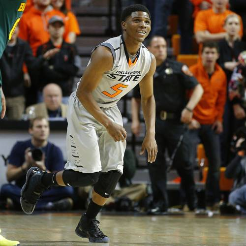 Oklahoma State's Stevie Clark (5) gets up after a play during an NCAA college basketball game between Oklahoma State University (OSU) and Baylor at Gallagher-Iba Arena in Stillwater, Okla., Saturday, Feb. 1, 2014. Baylor won 76-70. Photo by Bryan Terry, The Oklahoman