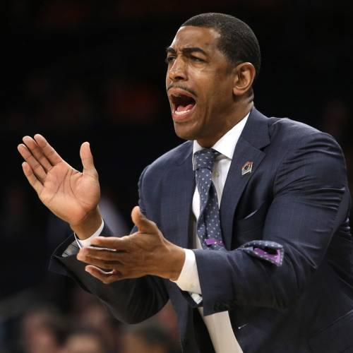 FILE - In this March 28, 2014 file photo, Connecticut coach Kevin Ollie shouts instructions during the first half in a regional semifinal against Iowa State in the NCAA men's college basketball tournament in New York. Ollie is listening to job offers, but isn't looking to leave Connecticut. The 41-year-old coach, who spent 13 years as an NBA journeyman before returning to his alma mater, has been linked to several NBA job openings. (AP Photo/Frank Franklin II, File)