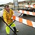 Workers put up a barricade on Hefner Rd because of flooding. Photo by John Clanton, The Oklahoman