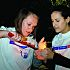 Sophomore Tiffany Palmer and freshman Leah Buller light a candle for the luminary ceremony Friday April 25, at Plunkett Park. (photo by Chanel Henry).