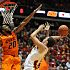 Iowa State's Georges Niang takes a shot as Oklahoma State's Michael Cobbins attempts to block during 1st half at Hilton Coliseum Wednesday, March 6, 2013, in Ames, Iowa. Photo by Nirmalendu Majumdar/Ames Tribune