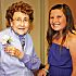 Cheyenne Middle School students served as greeters, took photos and interacted with their neighbors at Touchmark at Coffee Creek\'s \'senior\' prom.  Susanna LeMasters with Emma Joyce Broadrick, right.