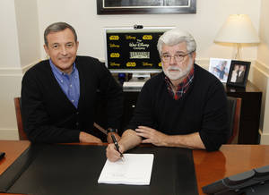 Photo - Disney President and CEO Robert Iger, left, and filmmaker George Lucas, of LucasFilm Ltd., are shown Tuesday in Burbank, Calif. The Walt Disney Co. announced Tuesday that it was buying Lucasfilm Ltd. for $4.05 billion. AP Photo