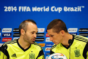 Photo - Spain's Andres Iniesta, left, and Fernando Torres talk during an official training session the day before the group B World Cup soccer match between Spain and Chile at the Maracana stadium in Rio de Janeiro, Brazil, Tuesday, June 17, 2014. Spain will play in group B of the Brazil 2014 World Cup. (AP Photo/Manu Fernandez)