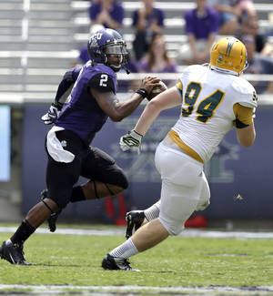 Photo - TCU quarterback Trevone Boykin (2) runs against Southeastern Louisiana defensive lineman Jacob Newman (94) during the second half of an NCAA college football game Saturday, Sept. 7, 2013, in Fort Worth, Texas. TCU 38-17.  (AP Photo/LM Otero)