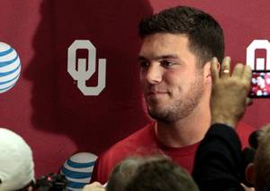 Photo -                    Tight end Blake Bell speaks with reporters during the OU football media day on Saturday in Norman.                                        Photo by Steve Sisney, The Oklahoman