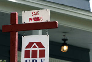 Photo -  A sign announces a residential home sale pending in Framingham, Mass.  AP Photo  <strong>Bill Sikes</strong>