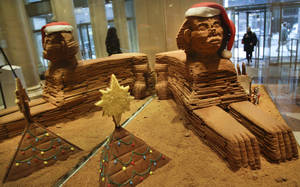 """Photo - This Nov. 30, 2012 photo shows""""The Sphinx,"""" a gingerbread creation from North End Grill, on display in the lobby area of Le Parker Meridien hotel in New York.  The landmark-inspired creation is being exhibited with other over-the-top gingerbread houses from city restaurants in the annual display to benefit City Harvest, a food rescue organization for feeding the needy.  (AP Photo/Bebeto Matthews)"""