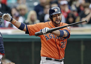 Photo - Houston Astros' Carlos Corporan reacts after striking out against Cleveland Indians relief pitcher Cody Allen in the seventh innings of a baseball game on Sunday, Sept. 22, 2013, in Cleveland. (AP Photo/Mark Duncan)