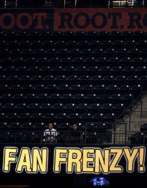photo -   There are few fans and no frenzy in this section of the ballpark during the third inning of a Houston Astros baseball game against the Chicago Cubs Wednesday, Sept. 12, 2012, in Houston. (AP Photo/Pat Sullivan)