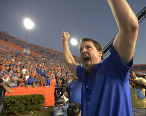 Photo -   Florida coach Will Muschamnp celebrates after Florida defeated South Carolina 44-11 in an NCAA college football game, Saturday, Oct. 20, 2012, in Gainesville, Fla. (AP Photo/Phil Sandlin)