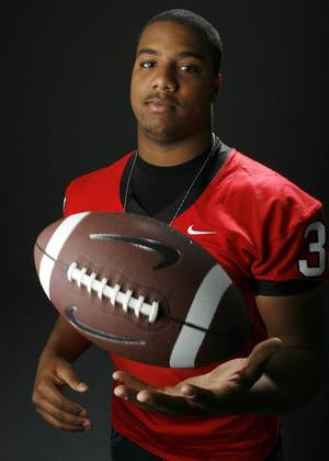 photo - HIGH SCHOOL FOOTBALL: All State football player Tracy Moore, Tulsa Union, in the OPUBCO studio, Wednesday, Dec. 17, 2008. BY NATE BILLINGS