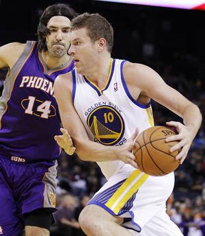 Photo -   Phoenix Suns' Luis Scola, left, defends against Golden State Warriors' David Lee during the first half of an NBA preseason basketball game, Tuesday, Oct. 23, 2012, in Oakland, Calif. (AP Photo/Ben Margot)