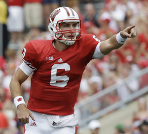 Photo -   Wisconsin quarterback Danny O'Brien celebrates after throwing a touchdown pass to Jared Abbrederis during the first half of an NCAA college football game against Northern Iowa Saturday, Sept. 1, 2012, in Madison, Wis. (AP Photo/Morry Gash)