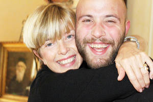 Photo - Above: Spencer Mellow, who wrote a Detox  Manifesto while in rehab, gets a hug from his mother, Patti Mellow, in this 2011 photo.  Photo Provided