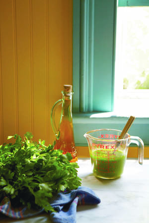 """Photo - A parsley-packed vinaigrette makes a tasty dressing for salads and lightly steamed vegetables. (Photo by Colin Clark for """"Hero Food"""" by Seamus Mullen, Andrews McMeel, 2012.)"""