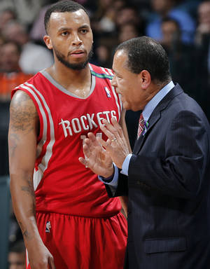 photo - Houston&#039;s Kelvin Sampson talks with Daequan Cook (14) during the NBA basketball game between the Houston Rockets and the Oklahoma City Thunder at the Chesapeake Energy Arena on Wednesday, Nov. 28, 2012, in Oklahoma City, Okla.   Photo by Chris Landsberger, The Oklahoman