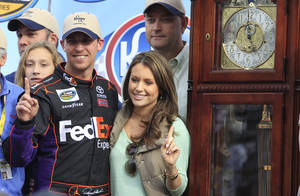 Photo -   Denny Hamlin (11) celebrates winning the NASCAR truck race with his girlfriend Jordan Fish at Martinsville Speedway with the winners trophy grandfather clock in Martinsville, VA., Saturday, Oct. 27, 2012. (AP Photo/Steve Helber)