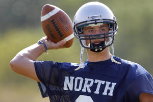Photo - Edmond North's Luke Hoskins drops back to pass during a 7-on-7 passing league for high school football at Edmond Santa Fe on Thursday, July 9, 2011. Photo by Bryan Terry, The Oklahoman  ORG XMIT: KOD
