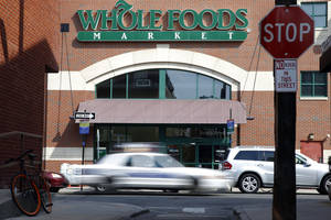 Photo - FILE - In this March 25, 2014, file photo, shows a Whole Foods store in Philadelphia. Whole Foods reports quarterly earnings on Tuesday, May 6, 2014. (AP Photo/Matt Rourke, File)
