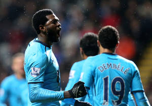 Photo - Tottenham Hotspur's Emmanuel Adebayor, left, celebrates his goal with his teammates during their English Premier League soccer match against Newcastle United at St James' Park, Newcastle, England, Wednesday, Feb. 12, 2014. (AP Photo/Scott Heppell)