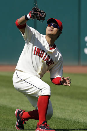 photo - FILE - In this Aug. 26, 2012, file photo, Cleveland Indians right fielder Shin-Soo Choo, from South Korea, catches a fly ball off the bat of New York Yankees' Chris Stewart in the seventh inning of a baseball game in Cleveland. The Indians traded Choo to the Cincinnati Reds and acquired prized pitching prospect Trevor Bauer from the Arizona Diamondbacks in a three-team deal Tuesday, Dec. 11. (AP Photo/Mark Duncan, File)