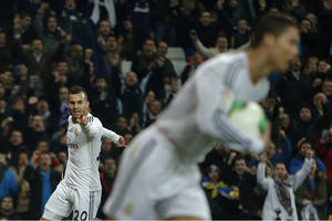 Photo - Real Madrid's Jese Rodriguez, left, celebrates his goal with Real Madrid's Cristiano Ronaldo from Portugal, right, during a Spanish Copa del Rey soccer match between Real Madrid and Osasuna at the Santiago Bernabeu stadium in Madrid, Spain, Thursday, Jan. 9, 2014. (AP Photo/Andres Kudacki)