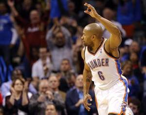 Photo - Oklahoma City 's Derek Fisher (6) celebrates a three-point play during the NBA game between the Oklahoma City Thunder and the Los  Angeles Clippers at the Chesapeake Energy Arena, Sunday, Feb. 23, 2014. PHOTO BY SARAH PHIPPS, The Oklahoman