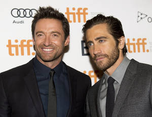 "Photo - Actors Hugh Jackman, left, and Jake Gyllenhaal pose for a photograph on the red carpet at the gala for the new movie ""Prisoners"" during the 2013 Toronto International Film Festival in Toronto on Friday, Sept. 6, 2013. (AP Photo/The Canadian Press, Nathan Denette)"