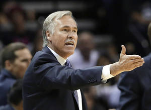 Photo - Los Angeles Lakers head coach Mike D'Antoni argues a call during the second half of an NBA basketball game against the San Antonio Spurs, Wednesday, April 16, 2014, in San Antonio. Los Angeles won 113-100. (AP Photo/Eric Gay)