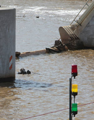 Photo - Oklahoma City Fire Department divers search for a victim of the May 31st storms in the Oklahoma River near May Avenue on Friday. Photo by David McDaniel, The Oklahoman <strong>David McDaniel - The Oklahoman</strong>