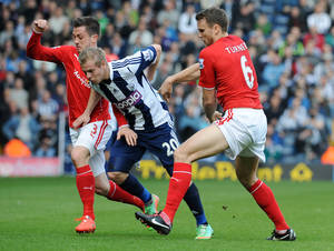 Photo - West Brom's Matej Vydra, centre,  is held by Cardiff's Ben Turner, right, and Andrew Taylor  during the English Premier League soccer match between West Bromwich Albion and Cardiff City at Hawthorns Stadium in West Bromwich, England, Saturday, March 29 2014. (AP Photo/Rui Vieira)