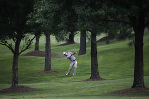 Photo - Peter Malnati hits an approach shot on the 6th hole during the first round of the St. Jude Classic golf tournament Thursday, June 5, 2014, in Memphis, Tenn. Malnati took a par on the hole. (AP Photo/Mark Humphrey)