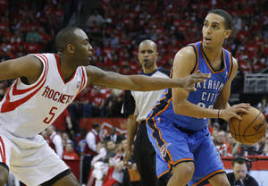 Photo - Oklahoma City's Kevin Martin (23) looks to pass the ball as Houston's James Anderson (5) defends during Game 6 in the first round of the NBA playoffs between the Oklahoma City Thunder and the Houston Rockets at the Toyota Center in Houston, Texas, Friday, May 3, 2013. Photo by Bryan Terry, The Oklahoman