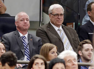 Photo - New York Knicks president Phil Jackson, right, watches during the first half of an NBA basketball game against the Toronto Raptors Wednesday, April 16, 2014, in New York. (AP Photo/Frank Franklin II)