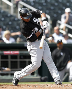 Photo - Chicago White Sox's Jose Abreu hits a two-run double against the Cleveland Indians during an exhibition baseball game in Goodyear, Ariz., Tuesday, March 4, 2014. (AP Photo/Paul Sancya)