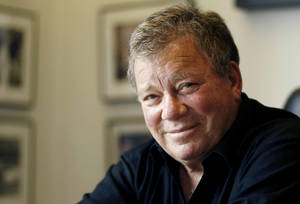 "Photo - In this Jan. 30, 2011 photo, Actor William Shatner poses for a portrait in Los Angeles. Captain James T. Kirk will be on hand when the aircraft carrier USS Enterprise is officially retired. A publicist for Shatner says the actor will attend the ship's inactivation ceremony Saturday, Dec. 1, 2012 at Naval Station Norfolk. Shatner is scheduled to perform Friday in Newport News. Shatner played Kirk at the helm of the starship Enterprise in the ""Star Trek"" television series and several movies. The world's first-nuclear powered aircraft carrier returned to Norfolk from its final deployment earlier this month. Saturday's inactivation will be its last public ceremony. (AP Photo/Matt Sayles)"