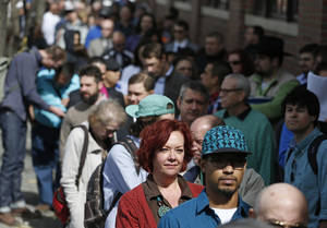 Photo - FILE - In this Thursday March 13, 2014, file photo, job seekers line up to attend a marijuana industry job far in Downtown Denver. The government issues the March jobs report on Friday, April 4, 2014. (AP Photo/Brennan Linsley, File)
