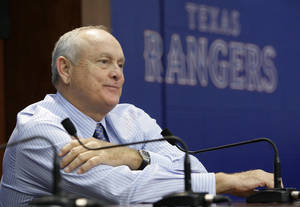 Photo - Texas Rangers team president Nolan Ryan sits at a news conference following the announcement the the ball club had acquired Seattle Mariners pitcher Cliff Lee in a trade before a baseball game against the Baltimore Orioles Friday, July 9, 2010 in Arlington, Texas. (AP Photo/Tony Gutierrez)
