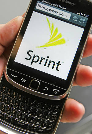 Photo - In this Monday, July 29, 2013, photo, a Sprint logo is displayed on a smart phone in Montpelier, Vt. Sprint Reports quarterly earnings on Tuesday, July 30, 2013. (AP Photo/ Toby Talbot)