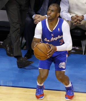 Photo -                    Los Angeles' Chris Paul lines up a 3-pointer Monday.