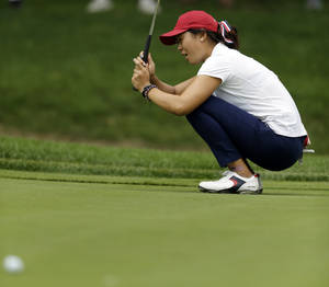 Photo - United States' Erynne Lee reacts after missing a putt on the second hole during second day of the 38th Curtis Cup amateur golf match against Great Britain and Ireland Saturday, June 7, 2014, in St. Louis. (AP Photo/Jeff Roberson)