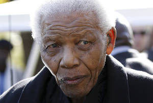 photo - FILE - In this June 17, 2010 file photo, former South African President Nelson Mandela leaves the chapel after attending the funeral of his great-granddaughter Zenani Mandela in Johannesburg, South Africa. South Africa's presidency says Mandela was admitted to a hospital for a scheduled medical check-up, Saturday, March 9, 2013. (AP Photo/Siphiwe Sibeko, Pool, File)