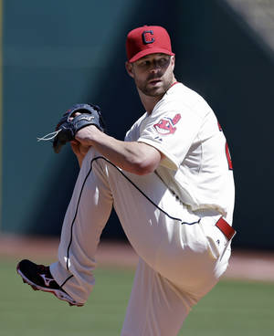 Photo - Cleveland Indians starting pitcher Corey Kluber delivers in the first inning of a baseball game against the Toronto Blue Jays, Saturday, April 19, 2014, in Cleveland. (AP Photo/Tony Dejak)