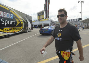 Photo - Tony Stewart walks through the garage area after a practice session for the NASCAR Sprint Cup auto race at Daytona International Speedway, Thursday, July 4, 2013, in Daytona Beach, Fla. (AP Photo/Phelan M. Ebenhack)