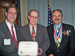 photo - Sons of the American Revolution Chapter President Martin A. Reynolds, retired 1st Sgt. Thomas C. Roman, and awards chairman and spokesman William R. Bill Melton are seen during a recent meeting, at which Roman was honored.  PHOTO PROVIDED BY CHAPTER MEMBER RAY MERITT
