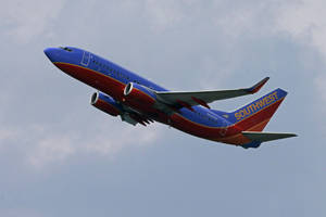 Photo - In this Tuesday, July 23, 2013, photo,  a Southwest Airlines jet taking off from Pittsburgh International Airport in Imperial, Pa. Southwest reports quarterly earnings on Thursday, July 25, 2013. (AP Photo/Gene J. Puskar)