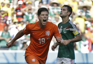 Photo - Netherlands' Klaas-Jan Huntelaar celebrates after scoring his side's second goal during the World Cup round of 16 soccer match between the Netherlands and Mexico at the Arena Castelao in Fortaleza, Brazil, Sunday, June 29, 2014.  The Netherlands won the match 2-1. (AP Photo/Natacha Pisarenko)