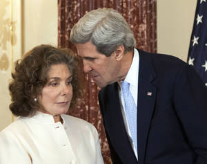 Photo - FILE - In this Feb. 6, 2013 file photo, Secretary of State John Kerry whispers to his wife Teresa Heinz Kerry during the ceremonial swearing-in for him as the secretary of state, at the State Department in Washington. Heinz Kerry was discharged from a Boston hospital Saturday July 27, 2013, just under three weeks after she suffered a seizure at their Nantucket home, a State Department spokesman said. Heinz Kerry, 74, is expected to make a full recovery from the July 7 seizure following additional outpatient treatment, spokesman Glen Johnson said.  (AP Photo/Manuel Balce Ceneta, File)