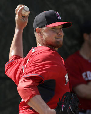 Photo - Boston Red Sox starting pitcher Jon Lester winds up for a throw during spring training baseball practice Thursday, Feb. 20, 2014, in Fort Myers, Fla. (AP Photo/Steven Senne)